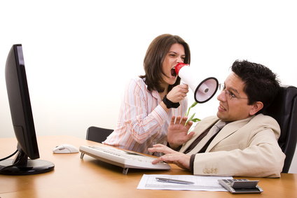 businesswoman shouting with her office worker (selective focus)