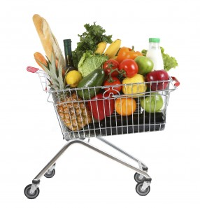 metal shopping trolley filled with products isolated on white